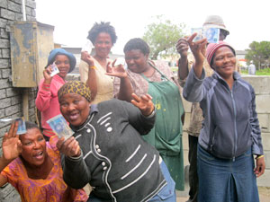 Happy Link of Love workers receive their R100