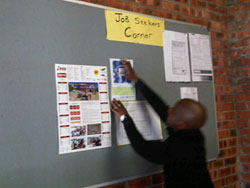 Putting up marketing material at SASSA Nyanga May 2014